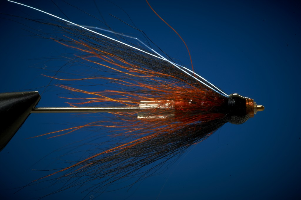 Tying a heavy tube fly for salmon on copper tube 5