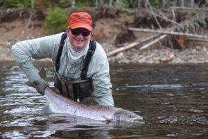 Big salmon on dry fly caddisfly